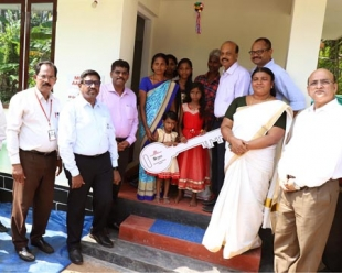 Muthoot M George Foundation hands over first disaster resilient home to a flood-affected family